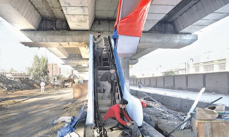 IN this file photo, workers install an escalator at a BRT station near Peshawar Cantt. The PTI's provincial government has allocated Rs14.29bn for transport sector under ADP 2019-20.—White Star