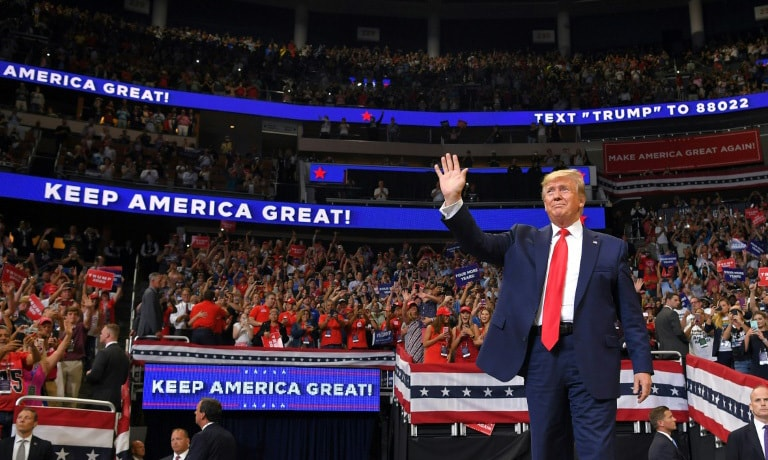 """""""We did it once and we're going to do it again,"""" Trump promised some 20,000 ecstatic supporters in Orlando, Florida. — AFP"""