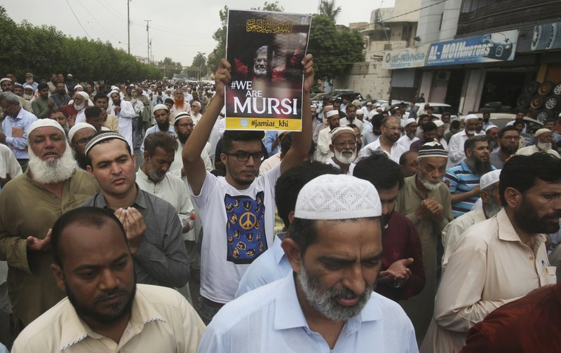 Supporters of Jamaat-i-Islami gather to offer a funeral prayer in absentia for ousted former Egyptian President Mohammed Morsi, in Karachi. ─ AP