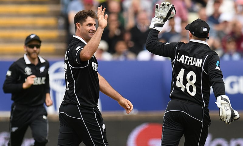 New Zealand's Colin de Grandhomme (C) celebrates with New Zealand's Tom Latham (R) the wicket of South Africa's Aiden Markram for 38 runs during the World Cup group stage match between New Zealand and South Africa at Edgbaston in Birmingham on June 19. — AFP