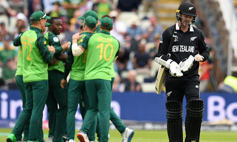 New Zealand's Colin Munro walks back to the pavilion after losing his wicket for nine runs during the World Cup group stage match between New Zealand and South Africa at Edgbaston in Birmingham on June 19. — AFP