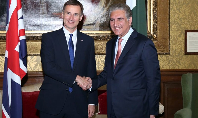 Foreign Minister Makhdoom Shah Mahmood Qureshi and British Foreign Secretary Rt. Hon. Jeremy Hunt shaking hands before the 4th review of the Pakistan-UK Enhanced Strategic Dialogue (ESD) at the Foreign and Common-wealth Office on June 19. — Pakistan High Commission