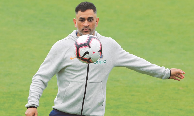 SOUTHAMPTON: Indian wicket-keeper M.S. Dhoni plays football during a training session at the Rose Bowl on Wednesday, ahead of their match against Afghanistan.—AP