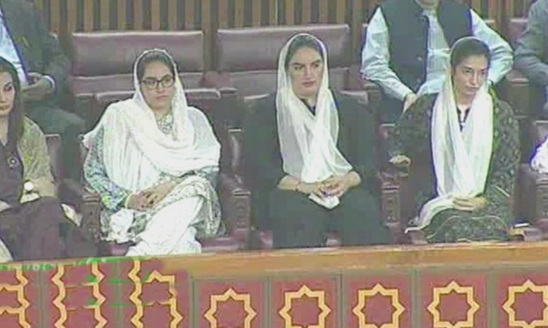 Aseefa Bhutto-Zardari and Bakhtawar Bhutto-Zardari watch as their father speaks in the house on Thursday. ─ DawnNewsTV