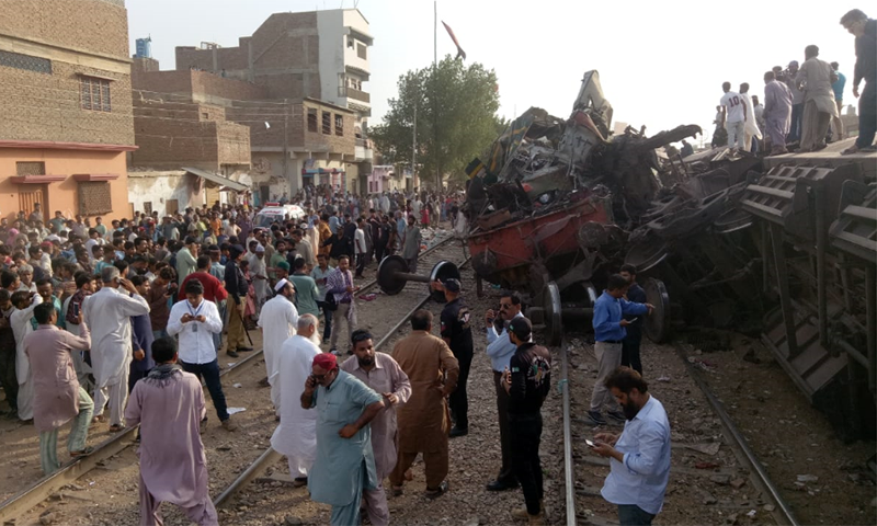 People gather around the wreckage of the derailed goods train. — Photo provided by Qazi Hassan