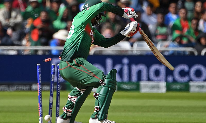 Bails fly as Bangladesh's Tamim Iqbal loses his wicket for 62 runs. — AFP