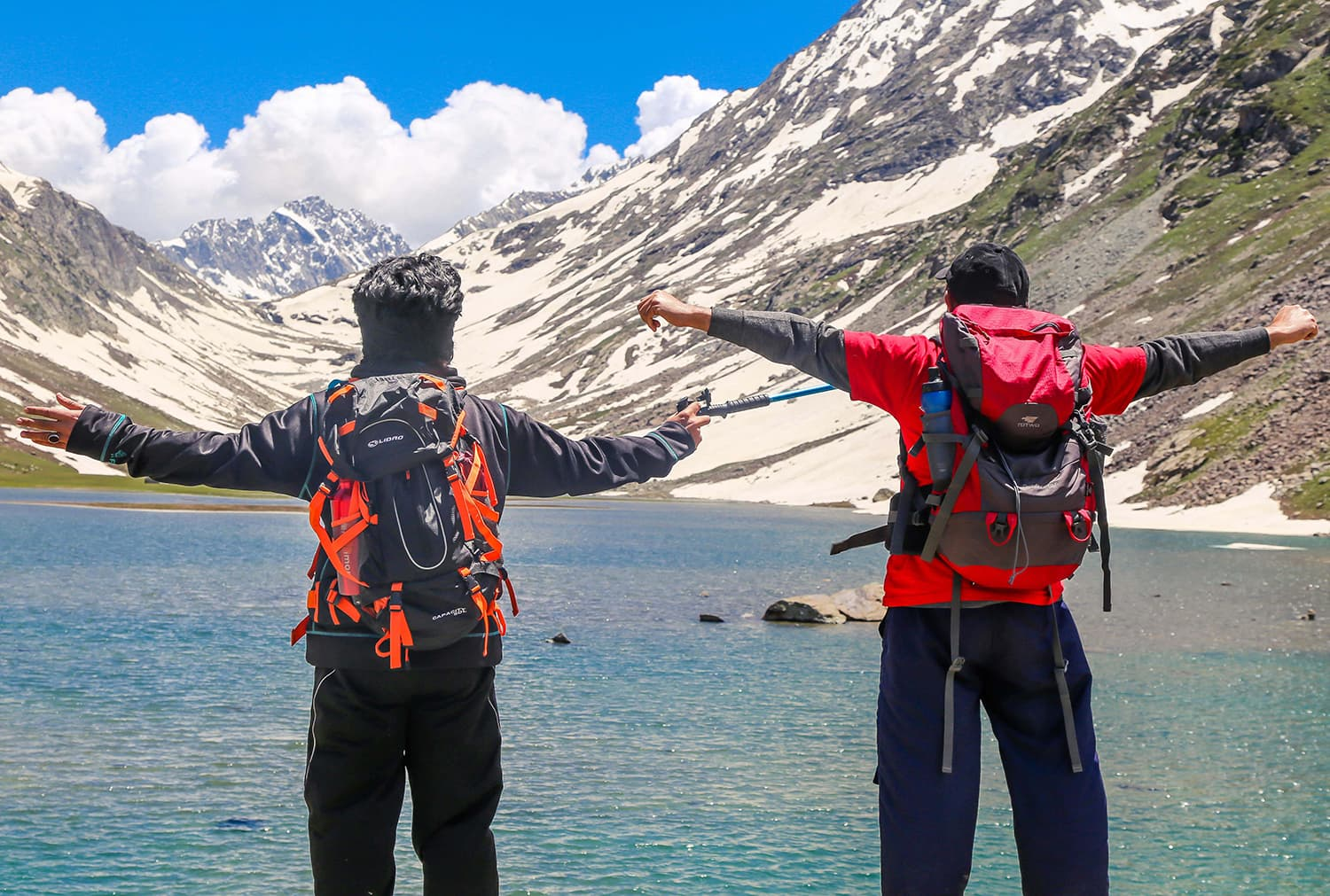 Jubilant trekkers pose for a photo in front of Izmis lake. ─ Photo by author