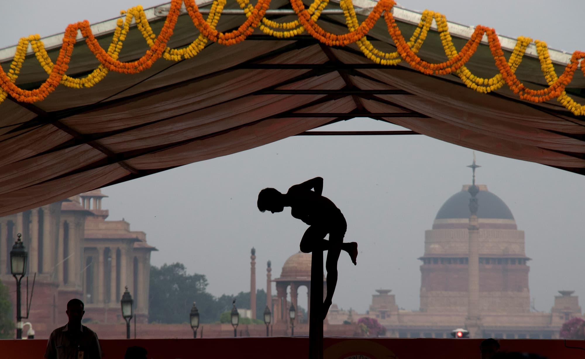 A boy performs on the mallakhamb, a traditional Indian sport, during International Yoga Day in New Delhi, India on  June 21. — AP