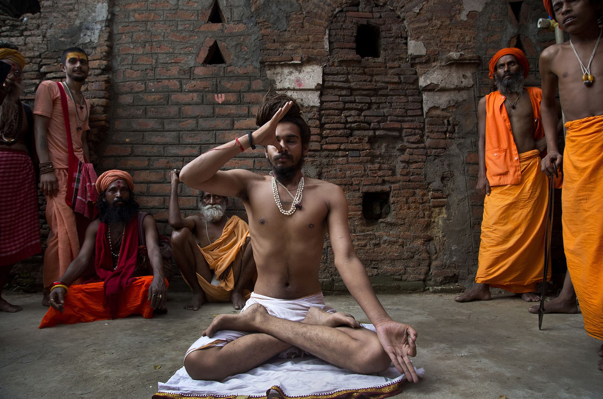 An Indian Sadhu, or Hindu holy man, performs yoga on International Yoga Day at Kamakhya temple in Gauhati, India on June 21. — AP