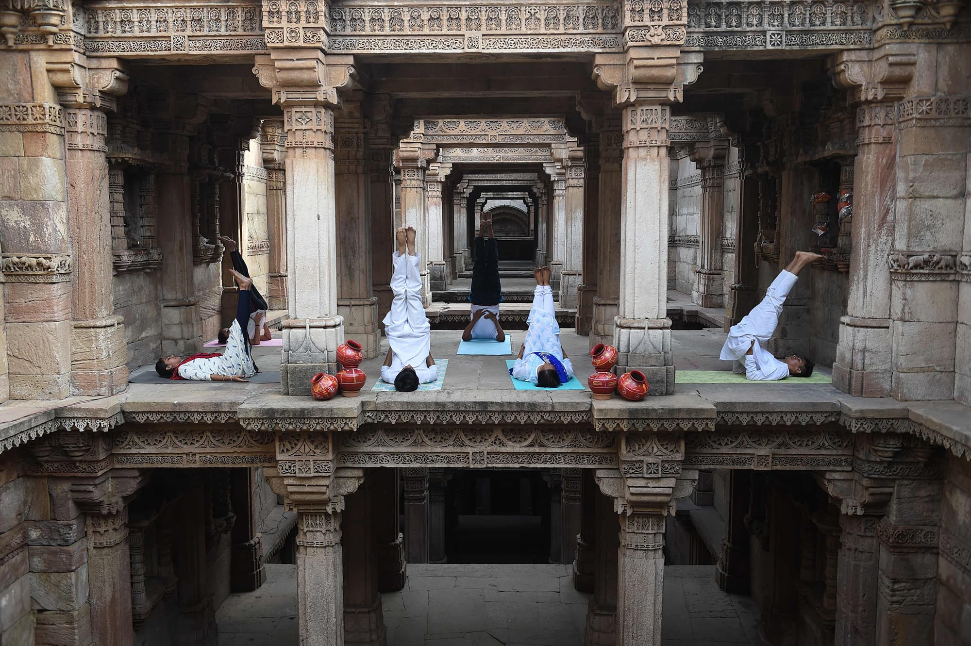 Indian yoga practitioners take part in a yoga session on International Yoga Day at the 15th century Adalaj Stepwell in Adalaj, some 40km from Ahmedabad in western Gujarat state, on June 21. — AFP