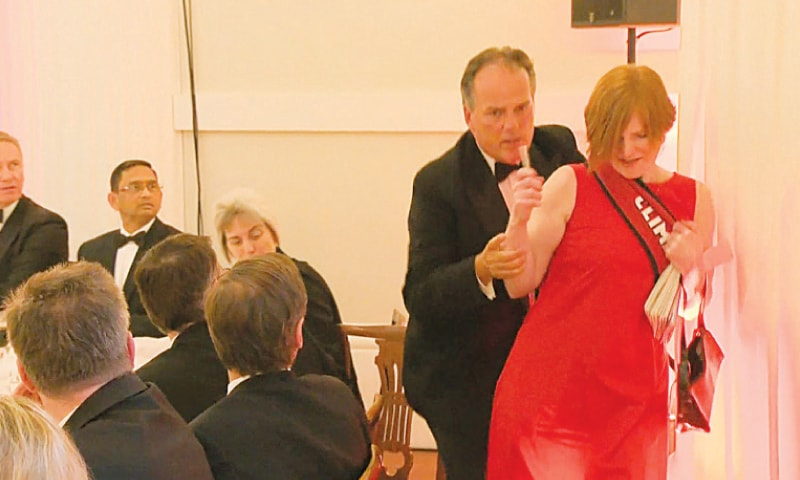 Mark Field tackling the Greenpeace climate protester at the dinner.—AFP
