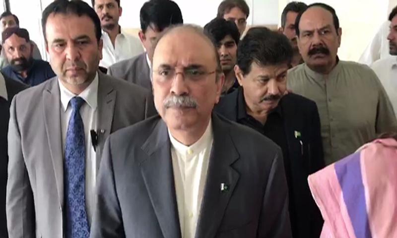 Former president Asif Ali Zardari talks to journalists outside the National Assembly. — DawnNewsTV