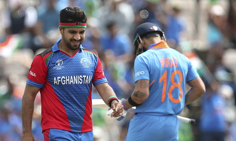 Afghanistan's Aftab Alam, left, reacts after a boundary hit by India's captain Virat Kohli, right, during the World Cup match between India and Afghanistan at the Hampshire Bowl in Southampton on June 22. — AP