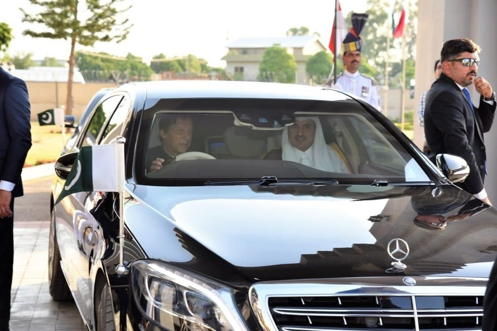 Prime Minister Imran Khan drove the Qatari leader to the PM House. — PID
