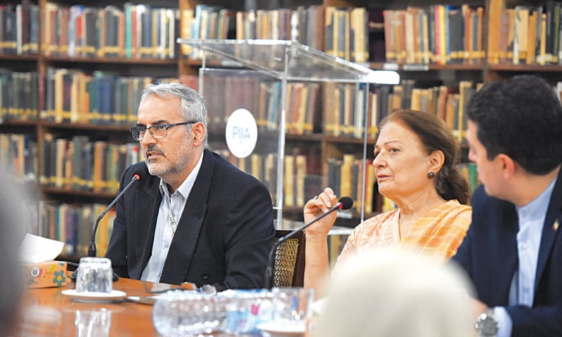 IRANIAN scholar Dr Mohammad Moini speaks at the PIIA on Saturday.—Tahir Jamal/White Star