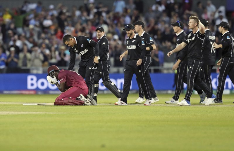 New Zealand's Ross Taylor consoles West Indies' Carlos Brathwaite at the end of the Cricket World Cup match between New Zealand and West Indies at Old Trafford in Manchester, England, on Saturday. — AP