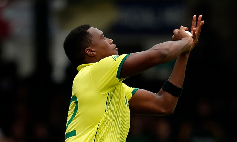 South Africa's Lungi Ngidi takes a catch to dismiss Babar Azam. ─ AFP