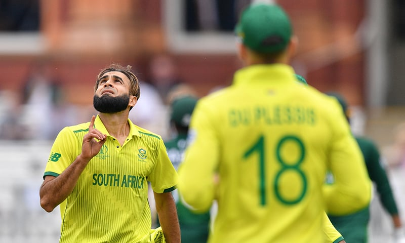 South Africa's Imran Tahir (L) gestures as he finishes his 10 overs. ─ AFP