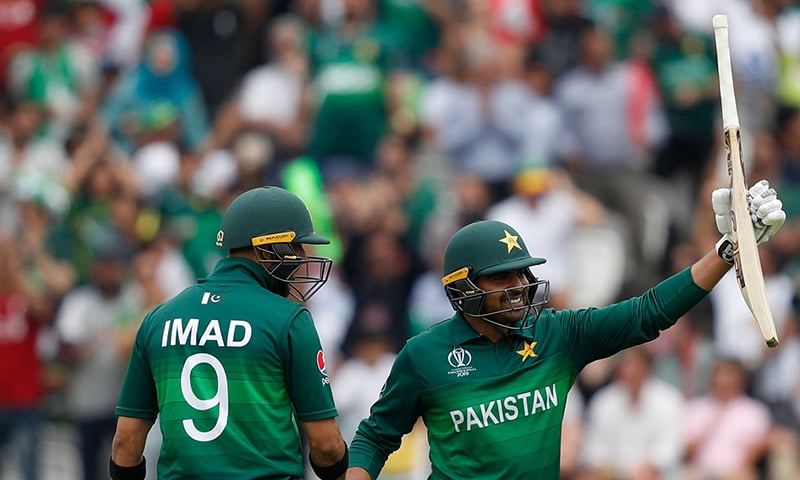 Haris Sohail (R) celebrates with Imad Wasim after scoring a half-century during the 2019 Cricket World Cup group stage match between Pakistan and South Africa at Lord's. ─ AFP