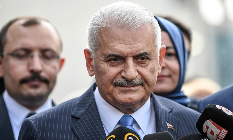 In this file photo taken on March 31, 2019 Turkish ruling Justice and Development Party (AKP) Istanbul mayoral defeated candidate Binali Yildirim speaks to media members as he arrives to the headquarters of the AKP in Istanbul. — AFP