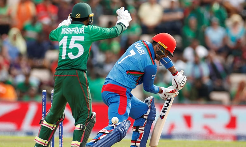 Afghanistan's Mohammad Nabi is bowled by Bangladesh's Shakib Al Hasan in their World Cup match at Rose Bowl in Southampton. — Reuters