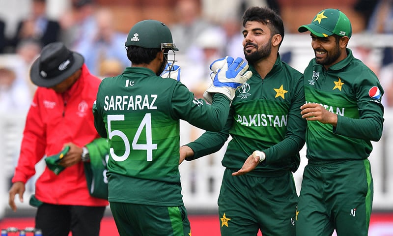 Shadab Khan (2R) celebrates with teammates Babar Azam (R) and captain Sarfaraz Ahmed (2L) after the dismissal of South Africa's Aiden Markram during the 2019 Cricket World Cup group stage match between Pakistan and South Africa at Lord's on June 23. — AFP