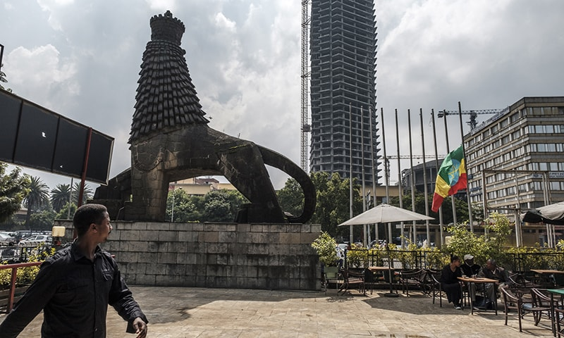 A view of the square in front of the National Theater of Ethiopia where the national flag is half lowered as the nation mourns in Addis Ababa on June 24. — AFP