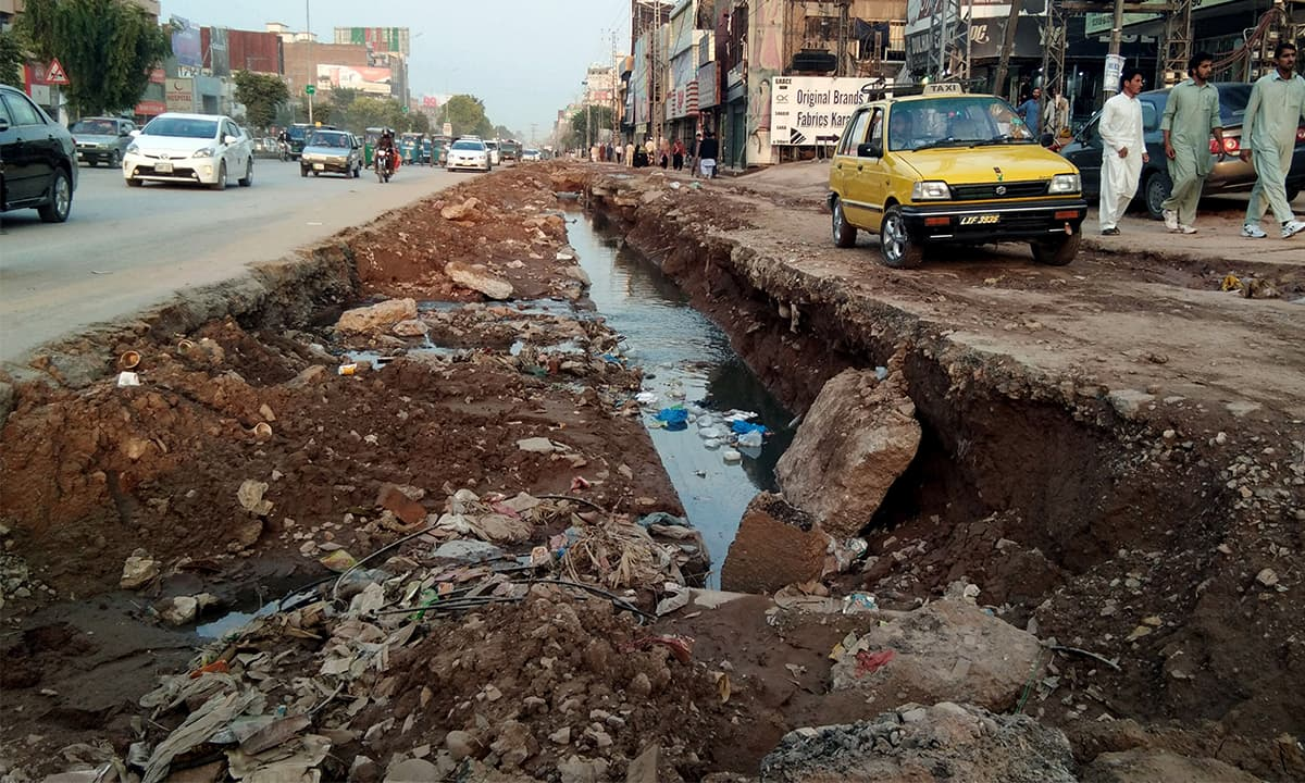 ork on a sewage line left incomplete on University road, Peshawar | Shahbaz Butt, White Star