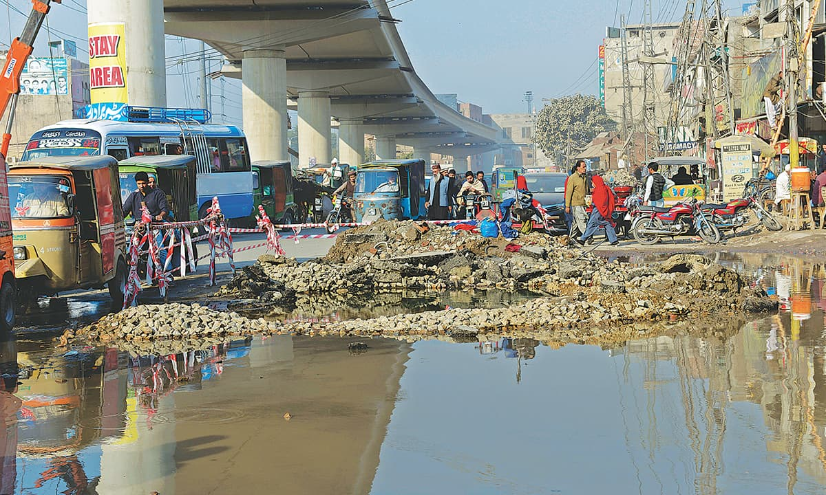 Sewage accumulated near an Orange Line  Metro Train bridge in Lahore | Murtaza Ali, White Star