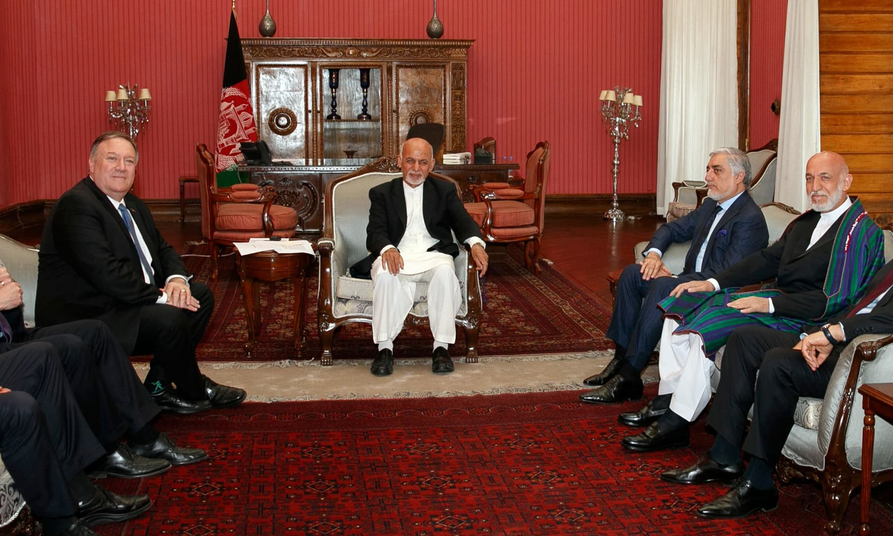 Secretary of State Mike Pompeo, left, meets with Afghan President Ashraf Ghani, Afghan Chief Executive Officer Abdullah Abdullah, and former Afghan President Hamid Karzai, right, at the Presidential Palace in Kabul. — AP