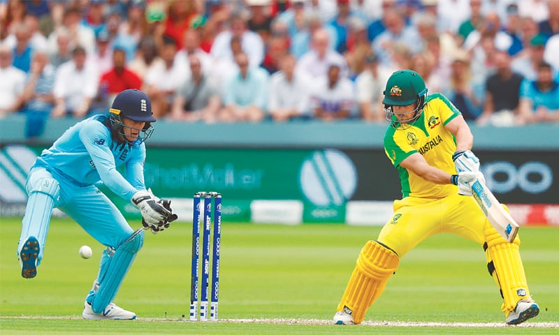 LONDON: Australian captain Aaron Finch cuts past England wicket-keeper Jos Buttler during their match at Lord's on Tuesday.—AFP