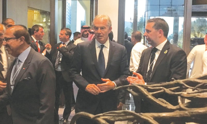 Manama: Former British prime minister Tony Blair (centre) arrives in the Bahraini capital to attend the conference.—AFP