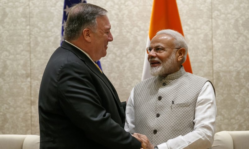 Secretary of State Mike Pompeo, left, shakes hands with Indian Prime Minister Narendra Modi, during their meeting at the Prime Minister's Residence in New Delhi, India, on Wednesday. — AP