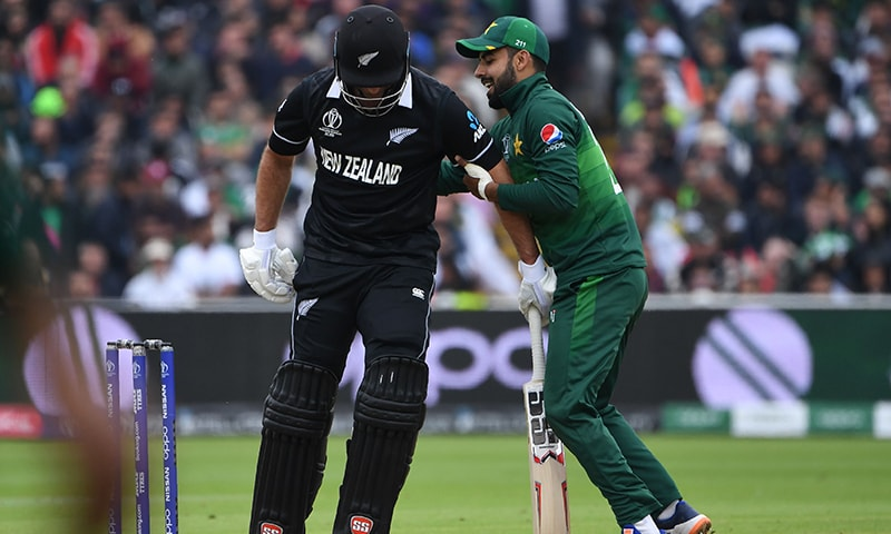 New Zealand's Colin de Grandhomme (L) collides with Shadab Khan during the 2019 Cricket World Cup group stage match between New Zealand and Pakistan at Edgbaston on June 26. — AFP