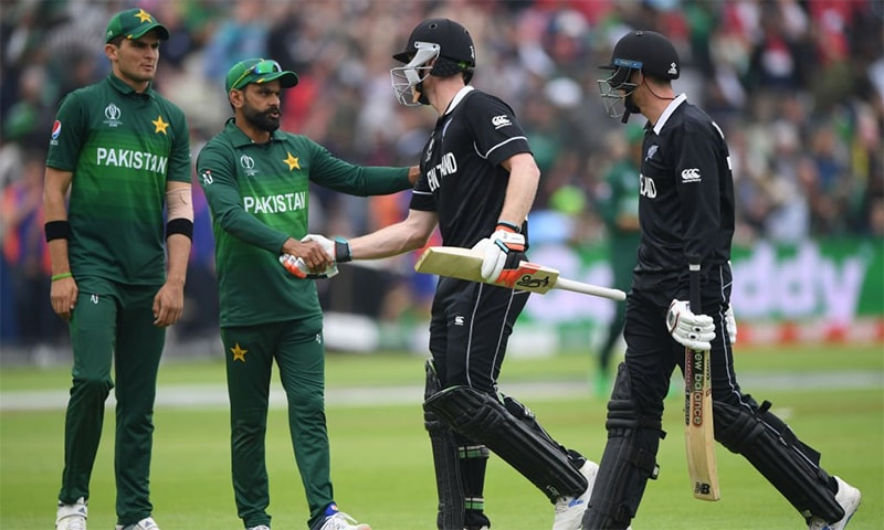 Mohammad Hafeez shakes James Neesham's hand after New Zealand wrapped their innings. — Cricket World Cup Twitter account
