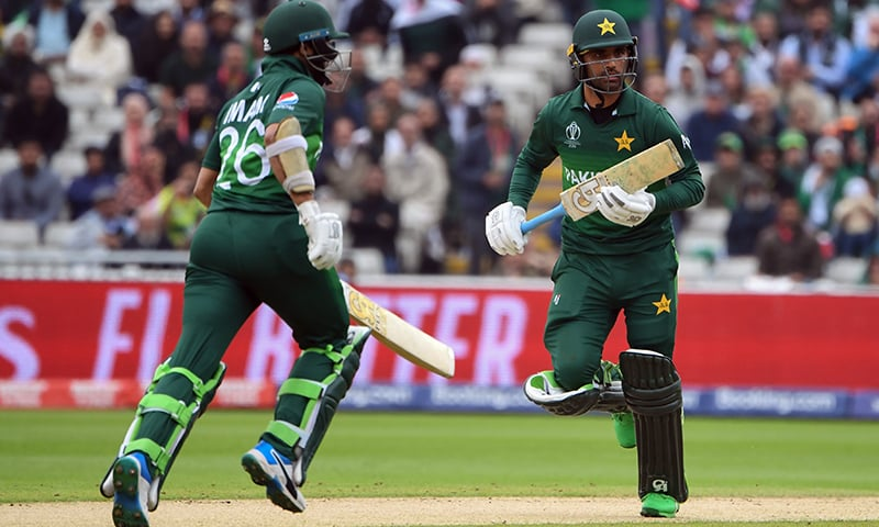 Pakistan's Imam-ul-Haq (L) and teammate Fakhar Zaman run between the wickets. — AFP