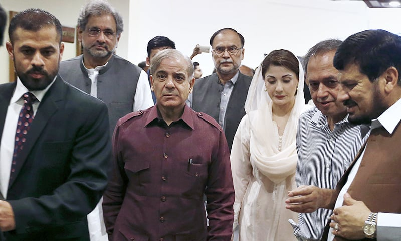 PML-N leaders Shehbaz Sharif, center,and Maryam Nawaz, third right, arrive with other party leaders to attend the multi-party conference in Islamabad. ─ AP