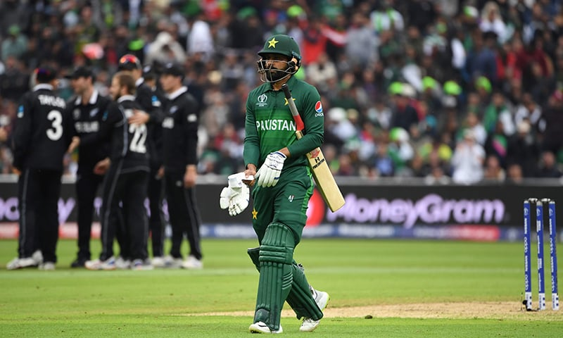 Mohammad Hafeez walking back after his dismissal. — AFP