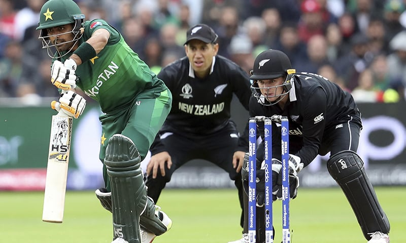 Pakistan's batsman Babar Azam, left, watches his shot New Zealand's Ross Taylor, middle, with wicketkeeper Tom Latham looks on. — AP