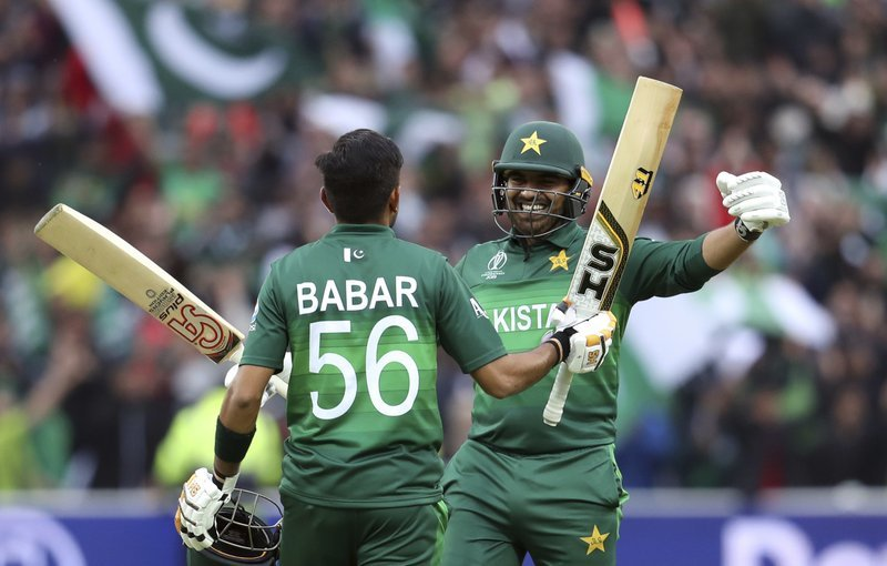 Haris Sohail, right, embraces teammate Babar Azam for scoring a century during the match between New Zealand and Pakistan at the Edgbaston Stadium. — AP