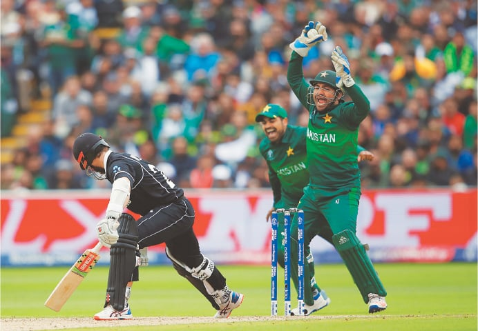 BIRMINGHAM: Pakistan captain Sarfraz Ahmed celebrates the dismissal of his New Zealand counterpart Kane Williamson during their match at Edgbaston on Wednesday.—Reuters