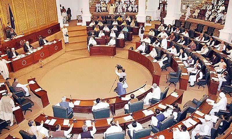 Opposition encircles speaker's dais, tears agenda copies. — APP/File
