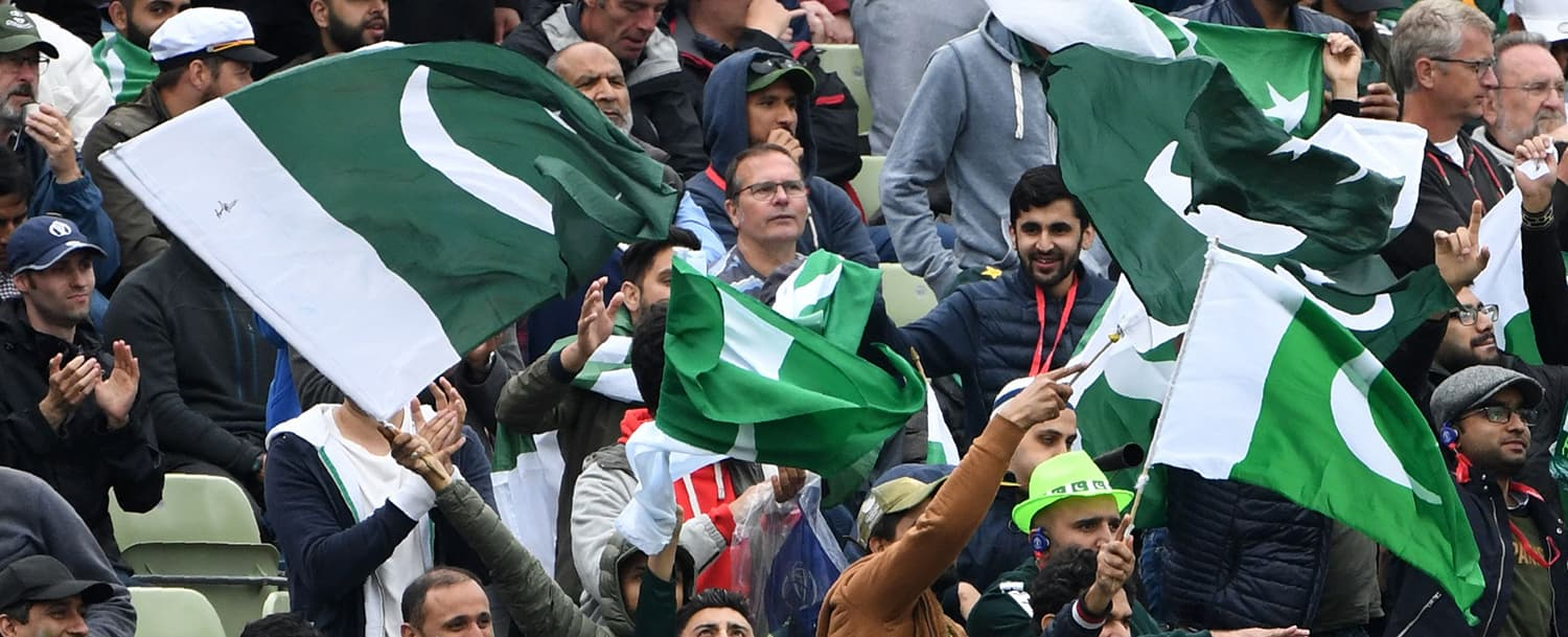 Pakistan supporters cheer during the 2019 Cricket World Cup group stage match between New Zealand and Pakistan at Edgbaston in Birmingham, central England, on June 26, 2019. (Photo by Paul ELLIS / AFP) / RESTRICTED TO EDITORIAL USE — AFP or licensors