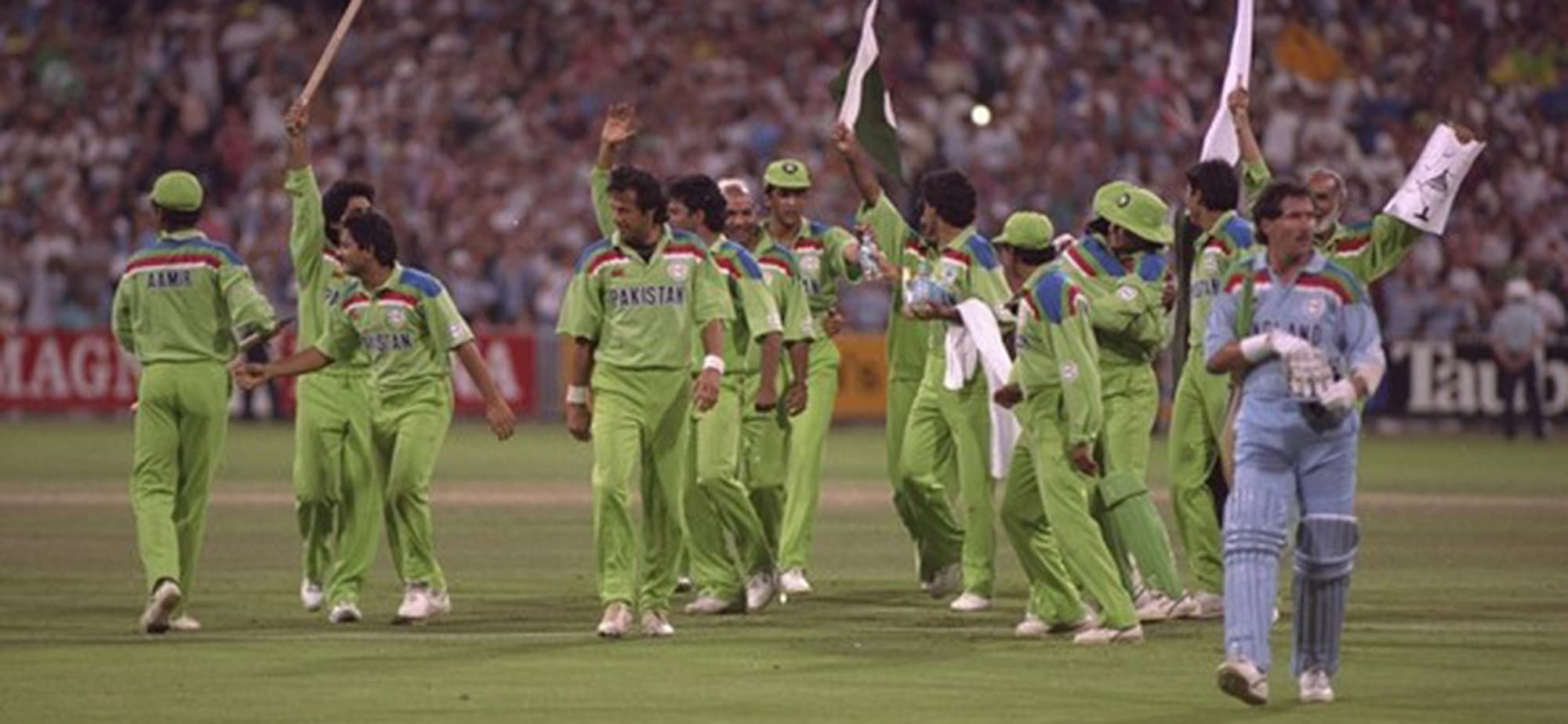 Imran Khan and the Pakistani cricket team celebrate victory in the 1992 World Cup. — Dawn archives