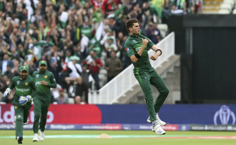 Shaheen Shah Afridi (left) took three wickets in his side's World Cup victory against New Zealand. ─ AP