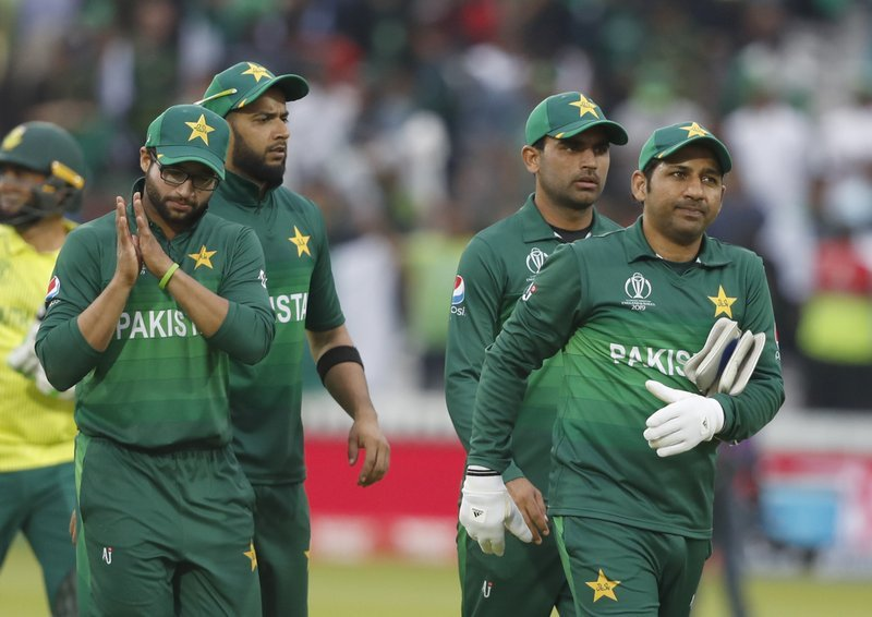 Sarfaraz Ahmed leads the team from the field as they celebrate after defeating South Africa by 49 runs. ─ AP