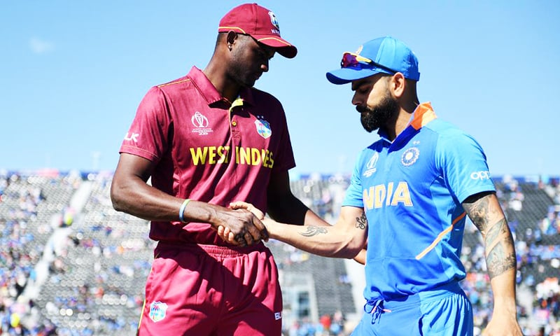 India captain Virat Kohli and West Indies skipper Jason Holder shaking hands after the toss. India win the toss and decided to bat first. — Photo courtesy of ICC Twitter