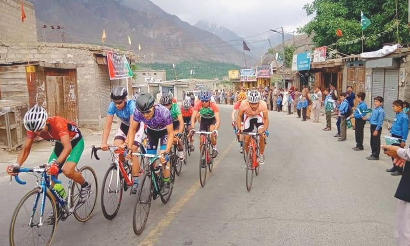 GILGIT: Participants of the Tour de Khunjerab cycle race passing through Thole Nagar at Karakoram Highway on Thursday.—Dawn
