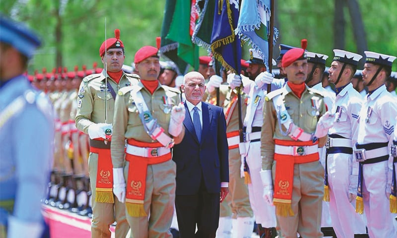 ISLAMABAD: Afghan President Ashraf Ghani reviews a guard of honour at PM House on Thursday.—APP