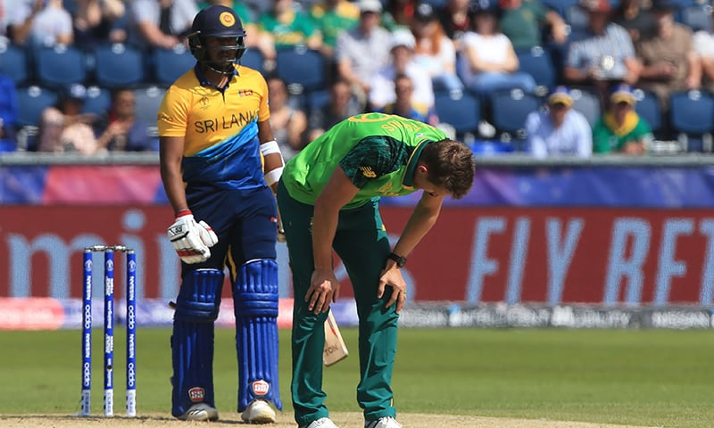 South Africa's Dwaine Pretorius (R) reacts after an unsuccessful appeal for the wicket of Sri Lanka's Avishka Fernando (L) during the 2019 Cricket World Cup group stage match between Sri Lanka and South Africa at the Riverside Ground on June 28. — AFP